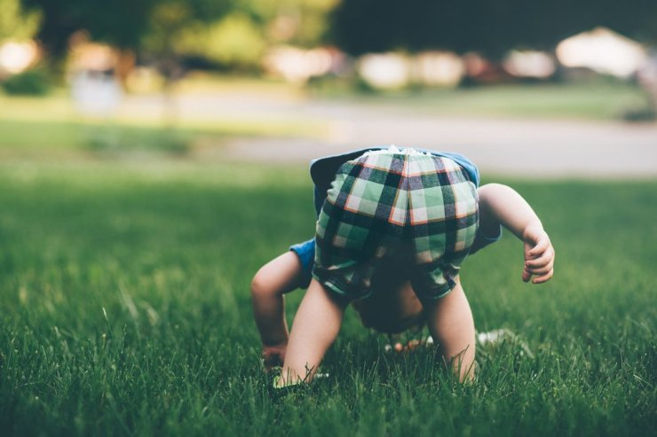 A boy curiously investigating the grass. Not knowing mind. Photo by Jordan Whitth.jpg